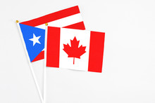 Canada And Puerto Rico Stick Flags On White Background. High Quality Fabric, Miniature National Flag. Peaceful Global Concept.White Floor For Copy Space.