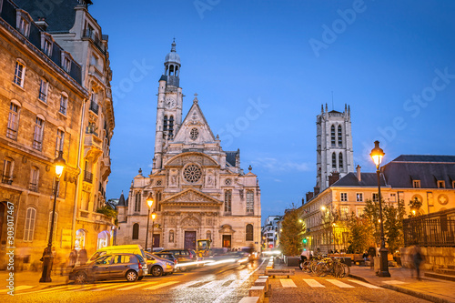 Foto auf Leinwand Altes Gebaude Illuminated streets of Paris during the blue hour in the evening, with Saint-Etienne-du-Mont church, Paris, France