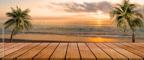 long wooden table with beach landscape blur background - 303026205