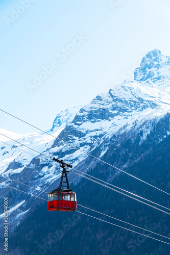 Obraz Ski cable car in the winter snow season. blue sky and mountains background. - fototapety do salonu