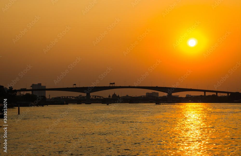 A sunset view of the Rama III Bridge, Bangkok, Thailand