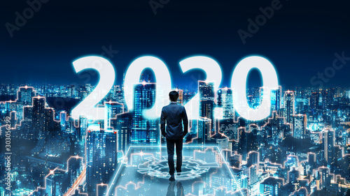 New year 2020 business man on future network city Fototapet