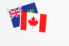 Canada And British Virgin Islands Stick Flags On White Background. High Quality Fabric, Miniature National Flag. Peaceful Global Concept.White Floor For Copy Space.