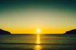 canvas print picture Sunset or sunrise over sea surface