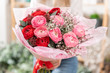 Beautiful bouquet of mixed flowers in womans hands. the work of the florist at a flower shop. Handsome fresh bouquet. Flowers delivery