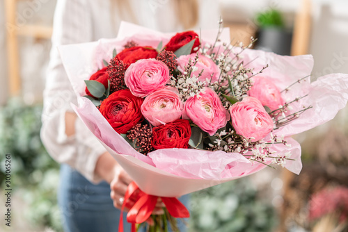 Beautiful bouquet of mixed flowers in womans hands Wallpaper Mural