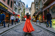 Woman Standing At Galata Tower...