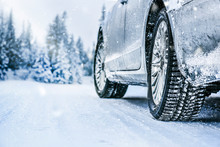 Winter Tire. Car Tire On Snow Road. Tires On Snowy Road Detail.