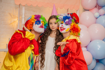 Clowns from the circus on the girls birthday. Party for children.