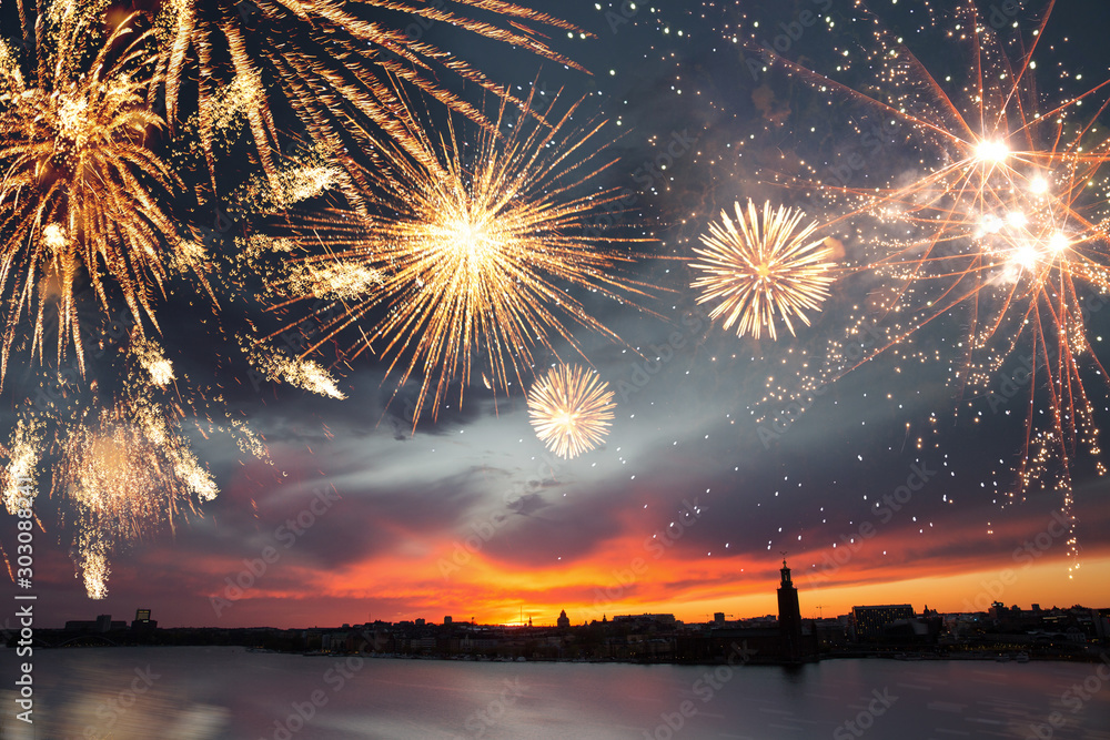 Fototapety, obrazy: Stockholm at dusk with fireworks. New Years eve and celebrations concept.