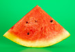 canvas print picture - Ripe red watermelon isolated on a green background