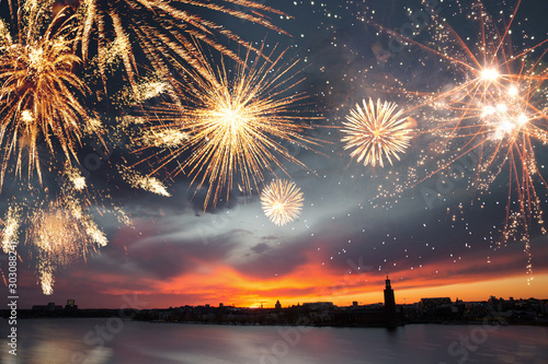 Obraz Stockholm at dusk with fireworks. New Years eve and celebrations concept. - fototapety do salonu