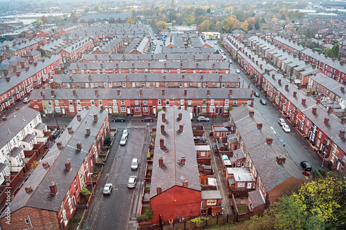 An aerial view of the roof tops, streets and roads of the Manchester district of Gorton Wallpaper Mural