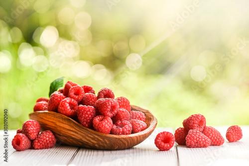 Fototapeta Fresh strawberries in rustic bowl on white table with glitter rounds and back light. obraz na płótnie