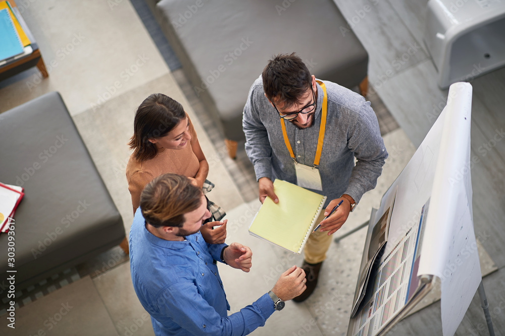 Fototapety, obrazy: Man and woman customer with salesman in store furniture for the house