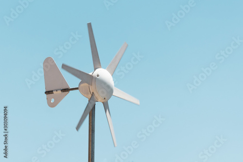 Wind vane and anemometer with rotating blades, wind power generation Wallpaper Mural