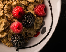 Detail Of A Plate Of Cereals With Blackberries And Raspberries. Great Breakfast.