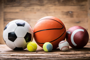 Sport Balls Arranged Over Rough Plank