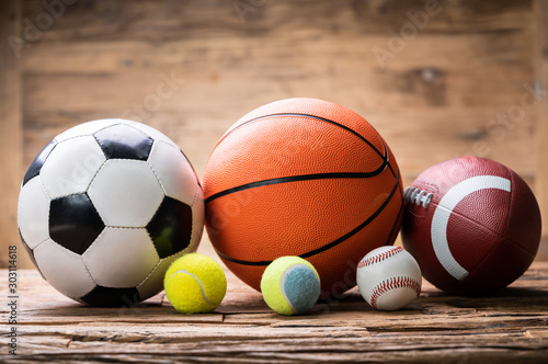 fototapeta na drzwi i meble Sport Balls Arranged Over Rough Plank