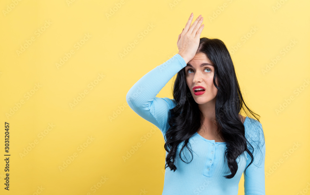 Fototapety, obrazy: Young woman making a mistake on a yellow background
