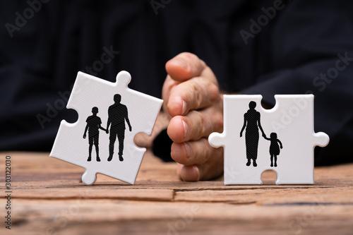 Dividing Two Jigsaw Puzzle Pieces Showing Divorce Concept Canvas Print