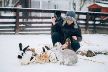 Photographer Having Fun And Taking Pictures In A Rabbit Park In Winter.
