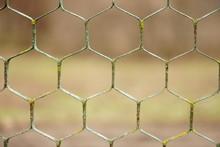 Old Rusty Hexagonal Mesh Fence...