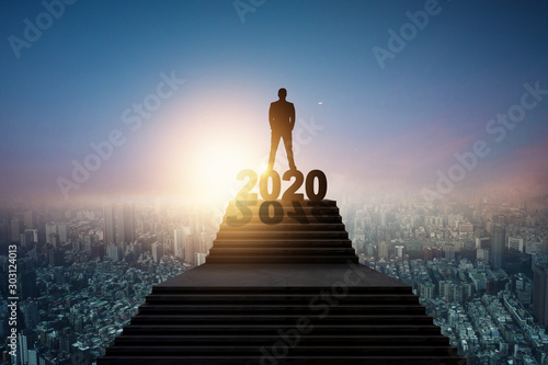 Fotografiet Success and leader of future concept, silhouette of businessman standing on 2020