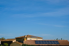 Solar Panels On Tiled Roofs. Sunny Autumn Day In Provence. Copy Space.
