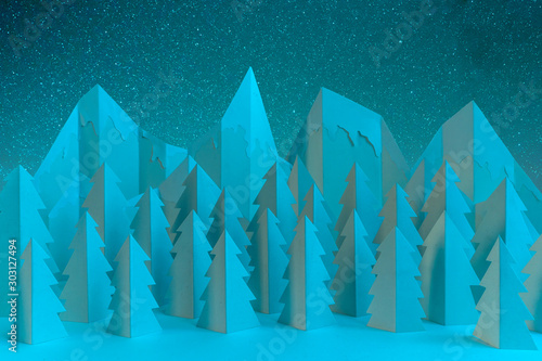 Foto auf AluDibond Blau türkis Winter paper landscape with mountains and pine trees at night