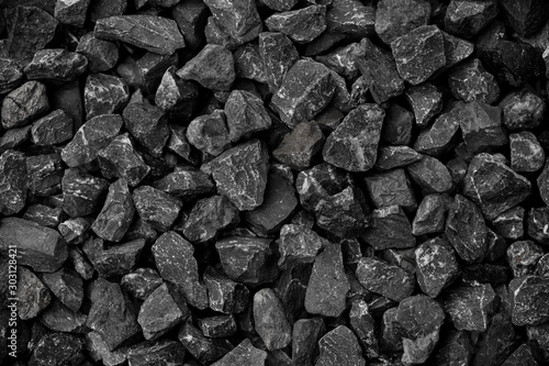 Natural black coals for background design. Industrial coals. Volcanic rock energy on earth. - 303128421