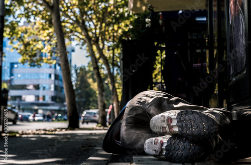 Homeless man, Poor homeless man or refugee sleeping on the concrete sidewalk flo Canvas-taulu