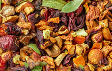 Winter Tea. Culinary Background. A Mixture For The Preparation Of Hot Warming Drinks From Rose Hips, Turmeric, Ginger, Hibiscus, Citrus Zest, Dried Apples, Cinnamon And Sage. Selective Focus, Top View