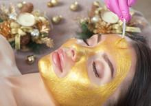 Beautician Makes A Golden Mask...