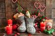Leinwanddruck Bild - Stiefel mit Suessigkeiten und Geschenken
