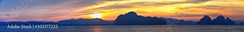 Obraz Islands Sunset, Ocean panorama views near Phuket with deep Red, Orange, Purple and Blue, mountains, twilight in Thailand. Including Phi Phi, Ko Rang Yai, Ko Li Pe and other islands. Asia. - fototapety do salonu