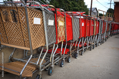 Old shopping carts lined up outdoors #303184689