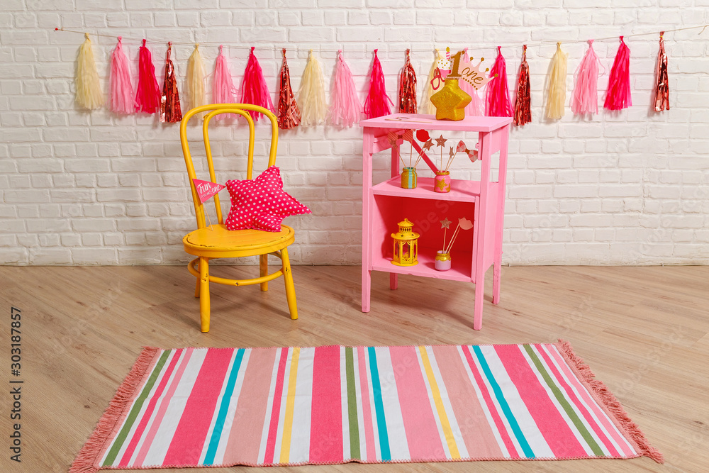 Photo zone with decorations for the birthday celebration for the girl. Idea for decorating pink style first year birthday party for little girl. Stylish props One year photo shoot for booth.