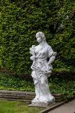 Statue Of A Woman In The Rocke...