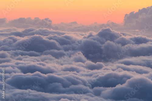Beautiful colorful dramatic sunset above clouds from Haleakala National Park. - 303193615
