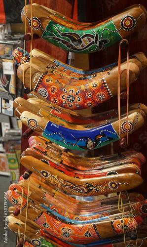 Aboriginal hand painted boomerangs on a rack Canvas Print