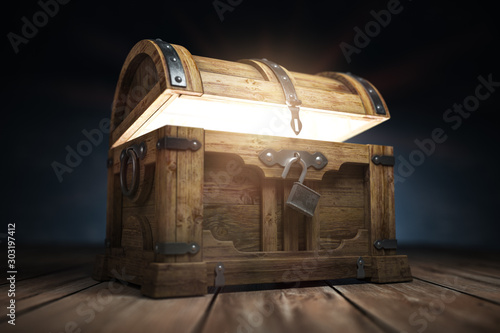 Fototapeta Old wooden treasure chest box with  glow from inside