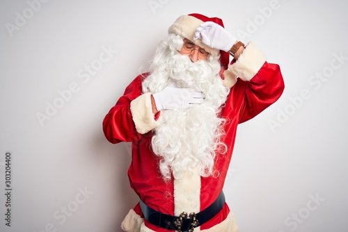 Carta da parati  Middle age handsome man wearing Santa costume standing over isolated white backg