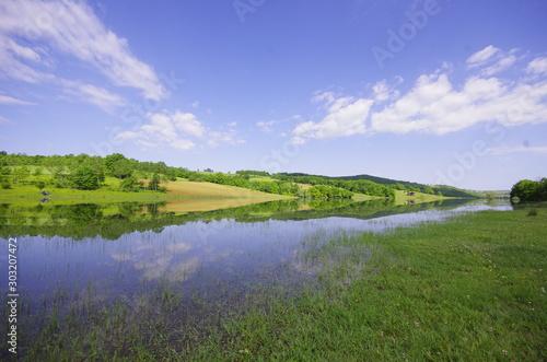 Fototapeta landscape with river and blue sky obraz na płótnie