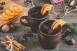 canvas print picture - Hot mulled wine with orange, cinnamon, honey and anise on wooden background.