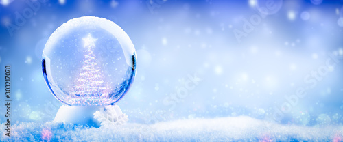 Photo  Colorful Snow Globe With Christmas Tree And Star Made Of Lights And Soft Falling