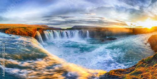 Fantastic sunrise scene of powerful Godafoss waterfall. Fototapeta
