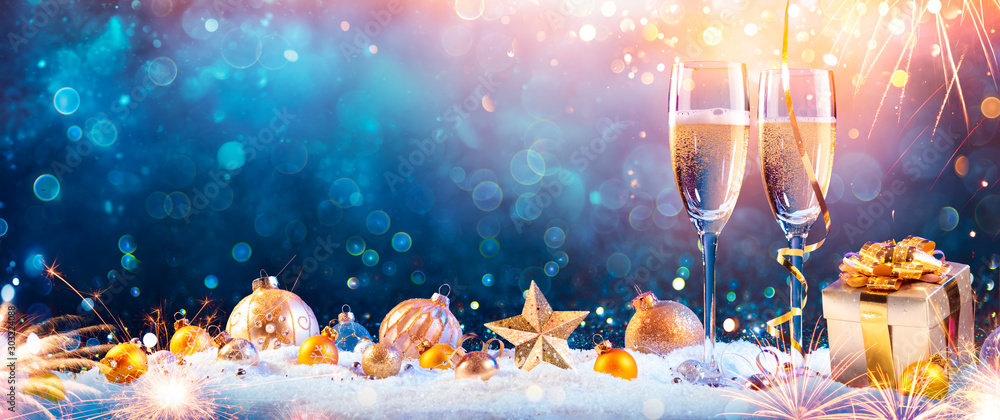 Fototapeta New Year Toast Champagne - Flutes With Christmas Decoration