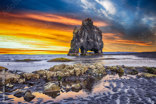 Obraz Dramatic sunset view of fHvitserkur unique basalt rock in Iceland - fototapety do salonu