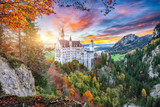 Majestic sunset view of famous Neuschwanstein Castle in autumn.